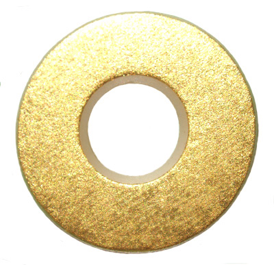 Photo of a gold plated flute pad